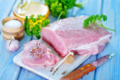 Raw meat. With spice on board and on a table Stock Photography