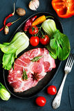 Raw meat. With spice and fresh vegetables Stock Photography