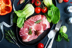 Raw meat. With spice and fresh vegetables Stock Images