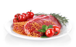 Raw meat with spice on plate Royalty Free Stock Photos