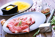 Raw meat. With spice on plate and on a table Royalty Free Stock Photo
