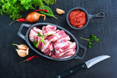 Raw meat. With spice and salt on a table Stock Images