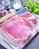 Raw meat. And spice on a table Stock Photos