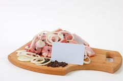Raw meat and spices Stock Images