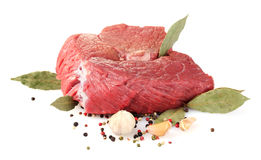 Raw  meat and spices. Over the white Royalty Free Stock Photography