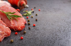 Raw meat with spices. On a black background Stock Images
