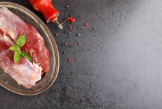 Raw meat with spices. On a black background Stock Photography