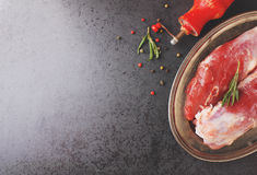 Raw meat with spices. On a black background Royalty Free Stock Images