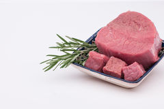 Raw meat with spices. Raw meat with greens in a bowl on a white background Stock Images