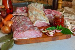 Raw meat and spices. On the kitchen table Royalty Free Stock Photography