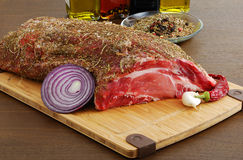Raw  meat with spices ready for cooking Stock Photos