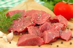 Raw meat with spices and vegetables. Prepared for baking Royalty Free Stock Images
