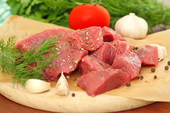 Raw meat with spices and vegetables. Prepared for baking Royalty Free Stock Photo