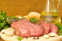 Raw meat with spices and vegetables ready for cooking Stock Photo