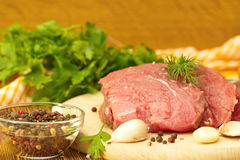 Raw meat with spices and vegetables ready for cooking. Piece of raw meat with spices and vegetables ready for cooking Stock Image