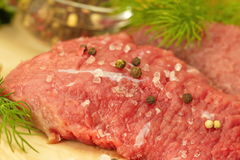 Raw meat with spices and vegetables ready for cooking Stock Photos