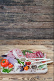 Raw meat, spices and vegetables. On rustic wooden board Royalty Free Stock Photography