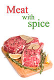 Raw meat with spices Stock Photos