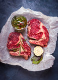 Raw meat steak on a baking paper ready to roasting Stock Images