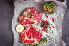 Raw meat steak on a baking paper ready to roasting Stock Photography