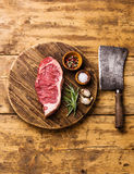 Raw meat steak and Butcher cleaver Royalty Free Stock Image