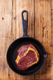 Raw meat steak on cast iron frying pan Royalty Free Stock Photo