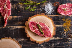 Raw meat steak on dark wooden background ready to roasting Stock Photo