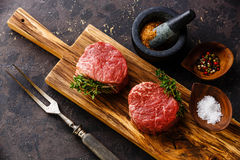 Raw meat Steak filet mignon and seasonings. Raw fresh marbled meat Steak filet mignon and seasonings on black background Stock Photography