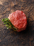 Raw meat Steak filet mignon and thyme. Raw fresh marbled meat Steak filet mignon and thyme on wooden background Royalty Free Stock Photo