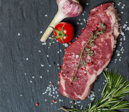 Raw meat steak with fresh herbs and salt Royalty Free Stock Photography