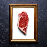 Raw meat steak in Gold picture frame Royalty Free Stock Images