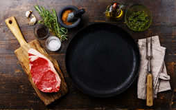 Raw meat Steak with ingredients and pan Stock Image