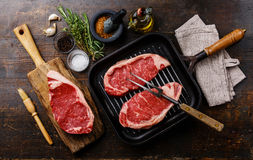 Raw meat Steak with ingredients and pan Royalty Free Stock Image