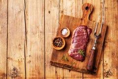 Raw meat Steak Machete. Raw fresh meat Steak Machete with salt and pepper on wooden background Stock Photography
