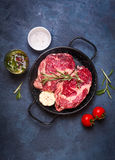 Raw meat steak in a pan ready to roasting Royalty Free Stock Image