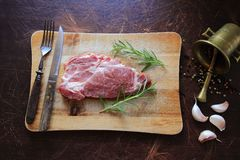 Raw meat for steak. Raw pork meat with ingredients. View from above Stock Photography