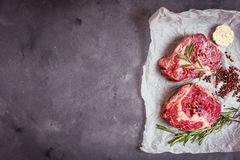 Raw meat steak on rustic concrete background ready to roasting Royalty Free Stock Image