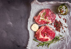 Raw meat steak on rustic concrete background ready to roasting Royalty Free Stock Photo