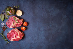 Raw meat steak on rustic concrete background ready to roasting Stock Photo