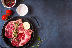 Raw meat steak on rustic concrete background ready to roasting Royalty Free Stock Photography