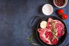 Raw meat steak on rustic concrete background ready to roasting Stock Images