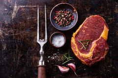 Raw meat Steak, seasoning and meat fork Stock Images
