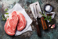 Raw meat Steak, seasonings, meat fork and cleaver Stock Photo