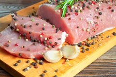 Raw meat steak. With spices on a cutting board Stock Photos