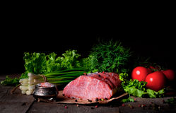 Raw meat steak with spices on a wooden board, selective focus.  Stock Images