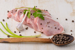 Raw meat steak on wooden board with spoon spices and garlic Royalty Free Stock Images