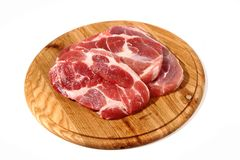 Raw meat steak on the wooden board Stock Photography