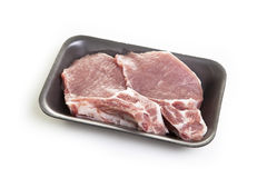 Raw meat steaks in the package. Raw meat steaks in the black package Stock Photo