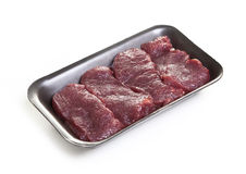 Raw meat steaks in the package. Raw meat steaks in the black package Royalty Free Stock Images