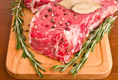 Raw Meat Steaks and Spices close-up Stock Photography